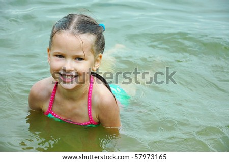 Little Girl Having Fun Swimming - stock photo