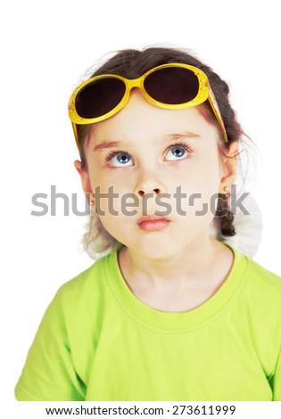 Little girl having fun wearing sunglasses on her forehead - stock photo