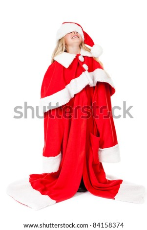 little girl having fun with a oversized santa claus costume