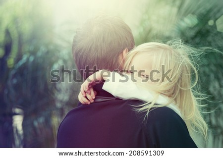 Little girl having fun with her daddy - stock photo