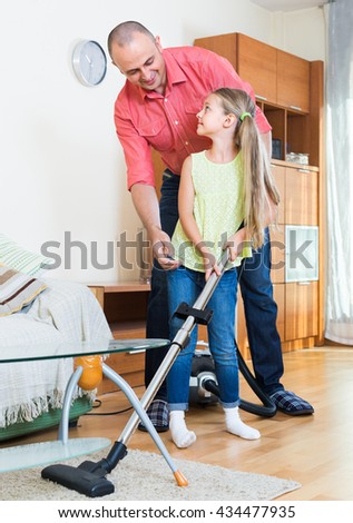 Little girl helping father to do regular clean-up