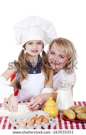 Little girl helping her mother prepare a cake, isolated on white background - stock photo