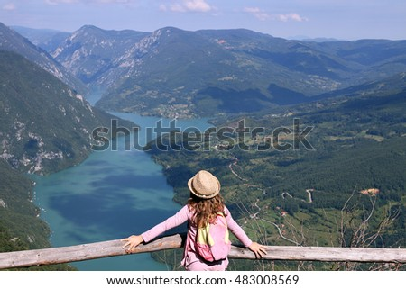 little girl hiker on mountain viewpoint