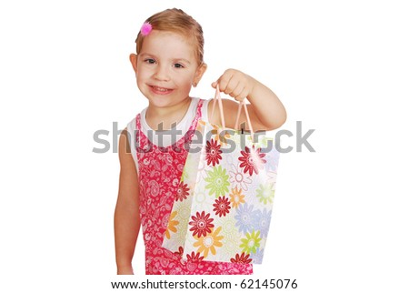 little girl hold shopping bag