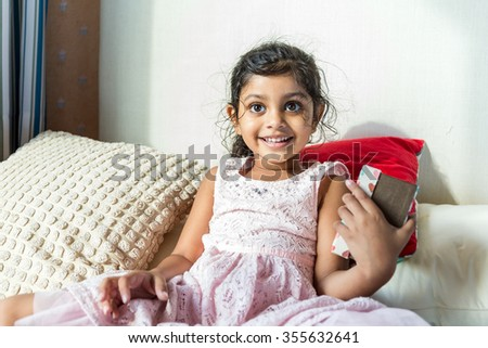 Little girl hold with gift box - stock photo