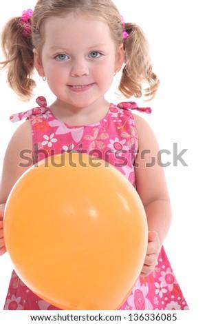 little girl holding a balloon - stock photo