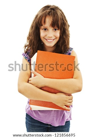 Little girl holding a big book. Isolated on white background - stock photo
