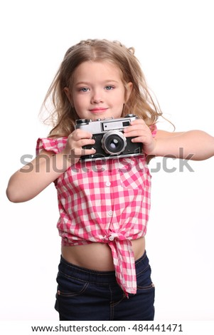 Little girl holding a camera. Close up. White background