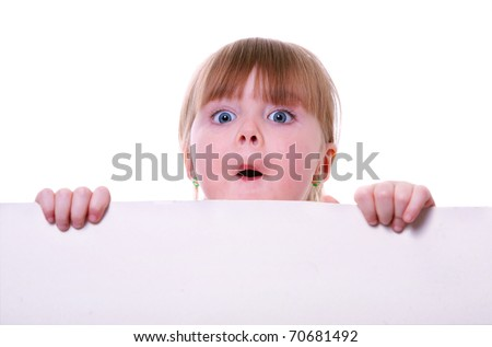 little girl holding a cardboard looking surprised. child hands.  isolated on white - stock photo