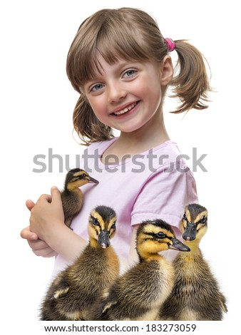 little girl holding a duckling - stock photo