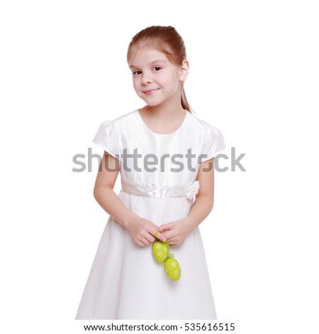 Little girl holding a Easter eggs