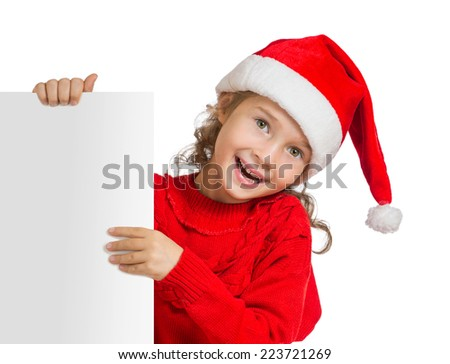 Little girl holding a poster in Santas hat on white