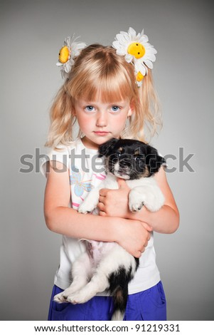 little girl holding a puppy - stock photo