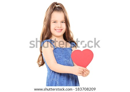 Little girl holding a red heart isolated on white background