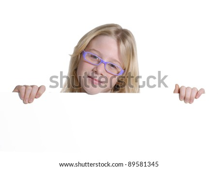 Little girl holding a white panel. - stock photo