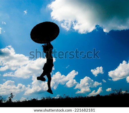 Little girl holding an umbrella, Happy jumping on a beautiful day. Silhouette concept - stock photo