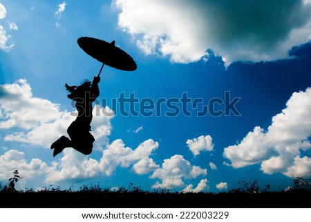 Little girl holding an umbrella, Happy standing on a beautiful day. Silhouette concept
