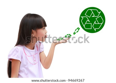 Little girl holding and blowing recycle symbol isolated on white