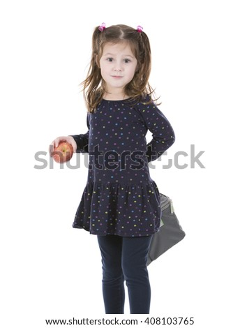 little girl holding bag with her lunch and apple - stock photo
