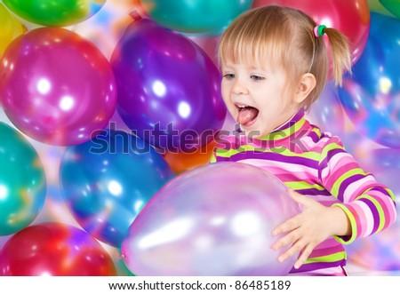 little girl holding balloons - stock photo