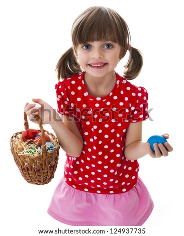 little girl holding basket with easter eggs - stock photo