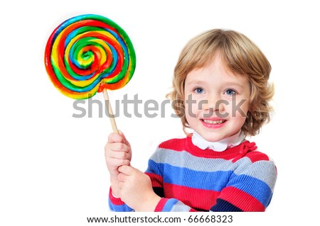 little girl holding big colorful lollipop - stock photo