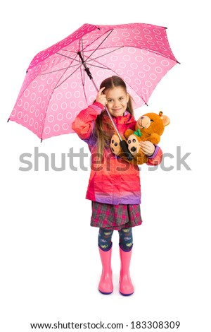 Little girl holding big pink umbrella and her teddy bear - stock photo