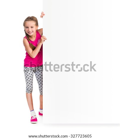 little girl holding big white blank for an advertisement - stock photo