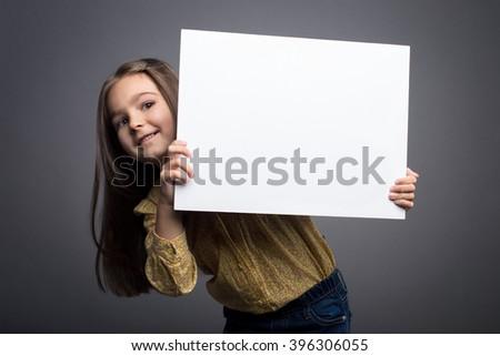 Little girl holding blank white board  - stock photo