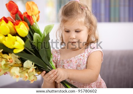 Little girl holding bouquet of tulips on mother's day.? - stock photo