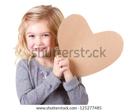 Little girl holding brown vintage heart, close-up isolated on white