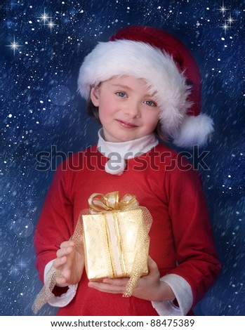 Little girl holding christmas gift box - stock photo