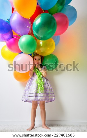little girl holding color balloons - stock photo