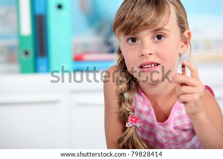 Little girl holding crayon