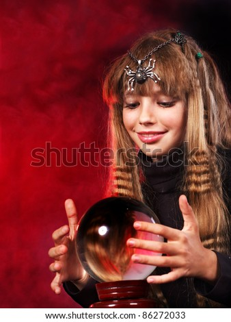 Little girl holding crystal ball. Fortune telling. - stock photo