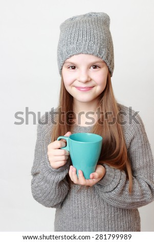 Little girl holding cup - stock photo