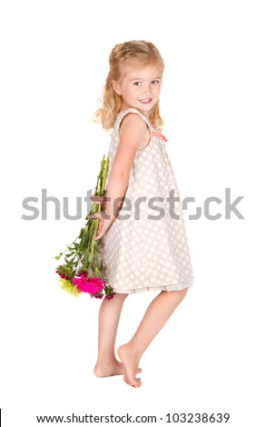 little girl holding flowers behind her back isolated on white