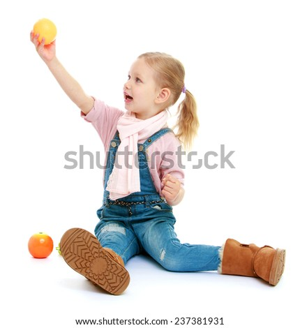 Little girl holding her at arm's length apple.Childhood education development in the Montessori school concept. Isolated on white background. - stock photo