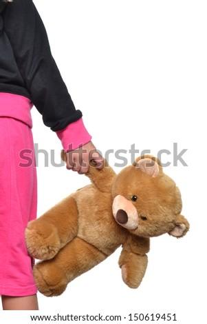 little girl holding her teddy bear - stock photo