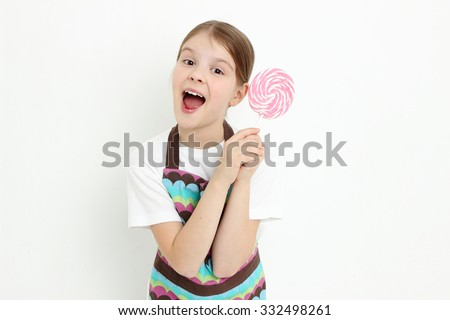 little girl holding lollipop - stock photo