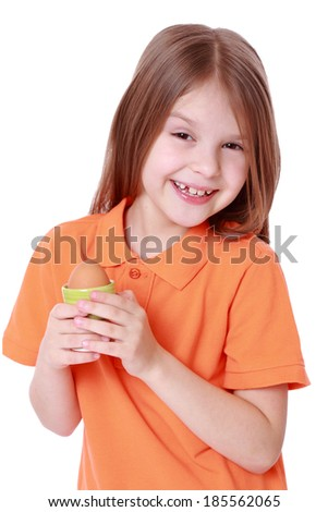 little girl holding one egg isolated over white