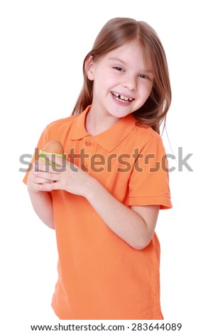 little girl holding one egg isolated over white - stock photo