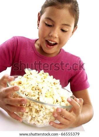 Little girl holding popcorn bowl. - stock photo