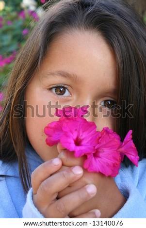 Little girl holding posy - stock photo