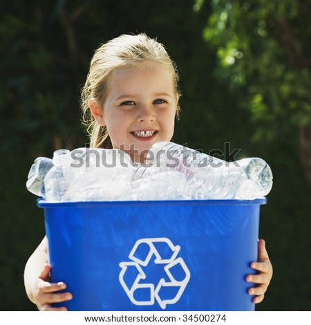 Little Girl Holding Recycling Bin - stock photo