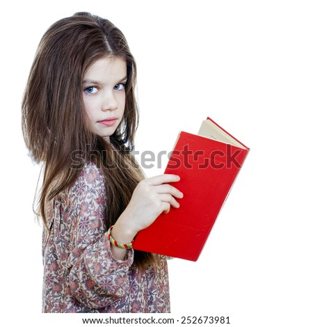 Little girl holding red book, studio on white background  - stock photo