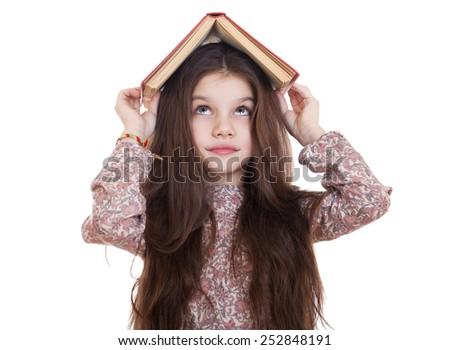 Little girl holding red book, studio on white background  - stock photo