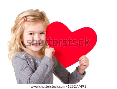 Little girl holding red heart, close-up isolated on white - stock photo