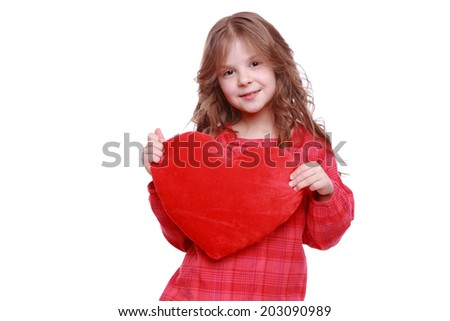 Little girl holding red heart/Little girl hugging a large toy heart isolated on white background