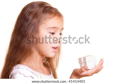 Little girl holding small gift box in hand - stock photo